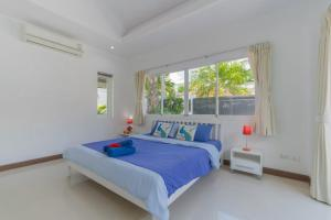 A bed or beds in a room at Private Pool Villa 4 bedrooms