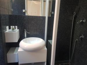Een badkamer bij Hotel Mignon