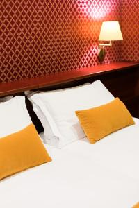 A bed or beds in a room at Madison Hotel