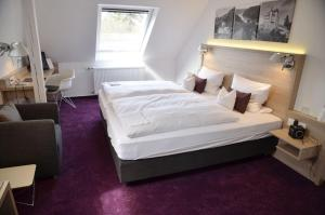 A bed or beds in a room at Tannenheim