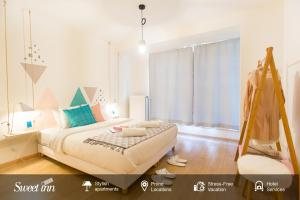 A bed or beds in a room at Sweet Inn Apartment - Monnaie