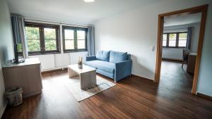 Ein Sitzbereich in der Unterkunft Gasthaus Zur Fähre
