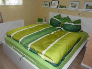 Ein Bett oder Betten in einem Zimmer der Unterkunft Ferienwohnung Winter