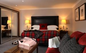 A bed or beds in a room at Macdonald Holyrood Hotel & Spa