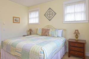 A bed or beds in a room at Compass Rose Three-Bedroom Home