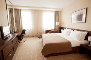 Кровать или кровати в номере Гостиница Кадашевская