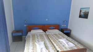 A bed or beds in a room at Christakis