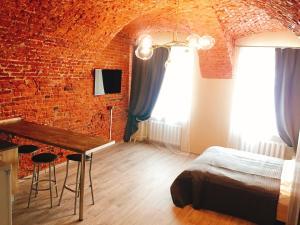 Кровать или кровати в номере Апартаменты на Караванной №1