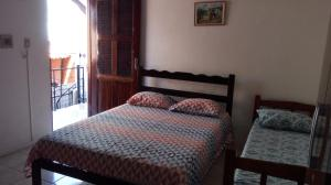 A bed or beds in a room at Suítes Centro Praia