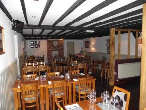 A restaurant or other place to eat at Horse & Groom Inn