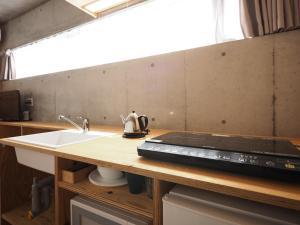 A kitchen or kitchenette at Smi:re Stay Oshiage