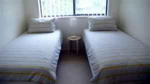 A bed or beds in a room at BARRELS AT BOOMERANG