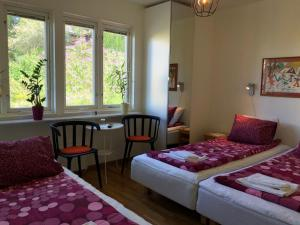 A bed or beds in a room at Sven Fredriksson Bed & Breakfast