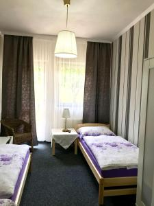 A bed or beds in a room at Privát u Jezu