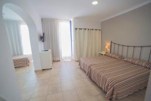 A bed or beds in a room at Casa Del Mar Hotel & Apartaments