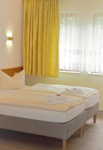 Ein Bett oder Betten in einem Zimmer der Unterkunft Pension Ujut