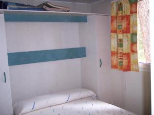 Cama o camas de una habitación en Camping Cobijo