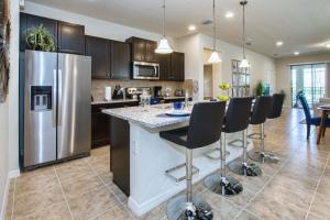 A kitchen or kitchenette at Windsor at Westside-6 Bedrooms House w/pool-3720WW