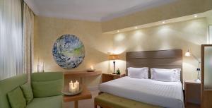 Letto o letti in una camera di Tombolo Talasso Resort
