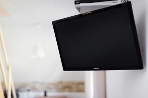Telewizja i/lub zestaw kina domowego w obiekcie Villa Apia