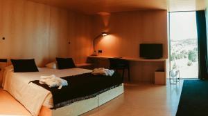 Uma cama ou camas num quarto em Cró Hotel Rural e Termal Spa