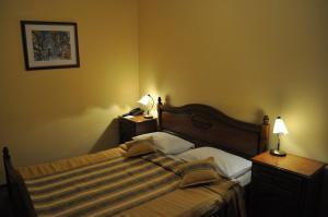 Cama o camas de una habitación en Wien Hotel