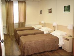 Кровать или кровати в номере ОтельОК