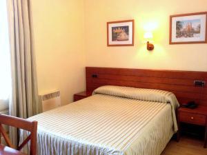 Un ou plusieurs lits dans un hébergement de l'établissement Hotel Toledano Ramblas