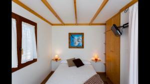 A bed or beds in a room at La Cerca Del Alcornoque