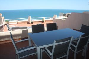 Un balcón o terraza de Fantástico apartamento en Faro de Cullera