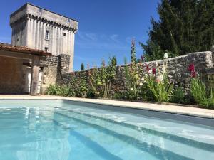 The swimming pool at or near Château de la Tour du Breuil