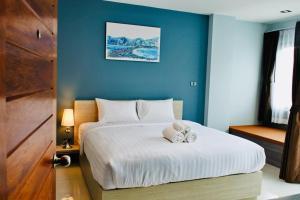 Ein Bett oder Betten in einem Zimmer der Unterkunft The Phu View at Aonang