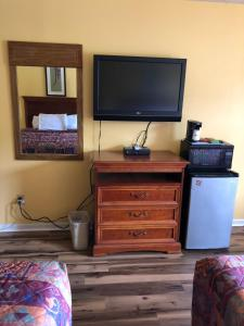 A television and/or entertainment center at Americas Best Value Inn - Jonesville