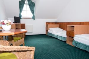 Postel nebo postele na pokoji v ubytování Penzion Oáza