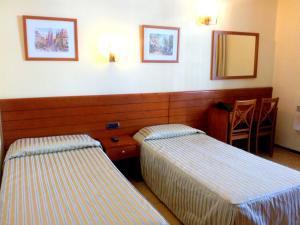 Letto o letti in una camera di Hotel Toledano Ramblas