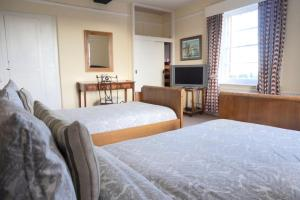 A bed or beds in a room at Colthrop Manor