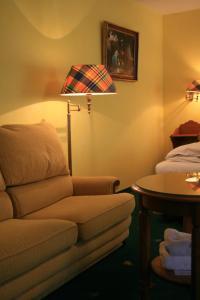 Ein Sitzbereich in der Unterkunft Hotel Wilder Mann
