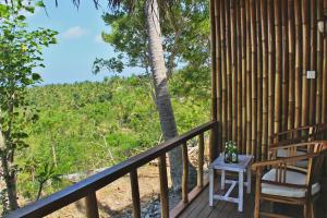 A balcony or terrace at Atuh Forest Cottage