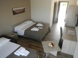 Un ou plusieurs lits dans un hébergement de l'établissement Zia Bi Bed and Breakfast