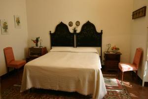 Letto o letti in una camera di Casa Billotta