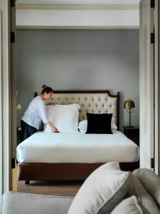 A bed or beds in a room at Indochinoise Residence