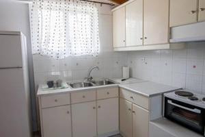 A kitchen or kitchenette at Memories Apartment Zakynthos