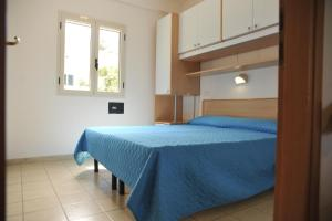 A bed or beds in a room at Villaggio San Pablo