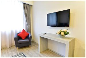 A television and/or entertainment centre at Ratchadamnoen Residence
