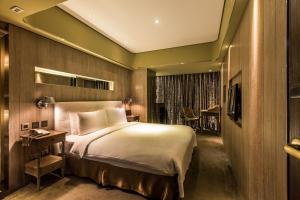 A bed or beds in a room at inhouse Hotel