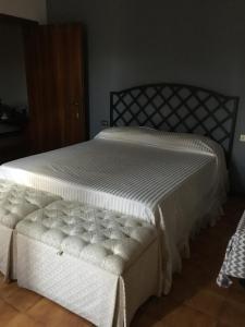Letto o letti in una camera di Casa Bellodi
