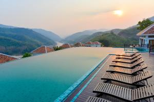 The swimming pool at or near Le Grand Pakbeng