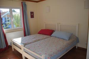 A bed or beds in a room at Aldeamento Turistico Casas da Comporta