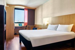 Cama o camas de una habitación en Ibis Barcelona Centro (Sagrada Familia)