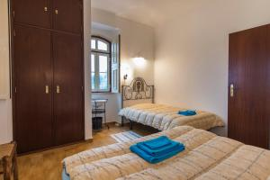 A bed or beds in a room at Quinta do Americano II